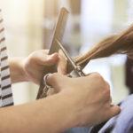close-up of a women having her hair cut
