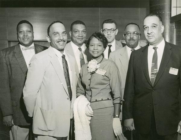UPWA (United Packinghouse Workers of America) delegates at 1957 convention with Herbert Hill. From left to right are Ollie Webb, Richard Miller, Charles Hayes, Addie Wyatt, Herbert Hill, Phil Weightman, and Russell Lasley.