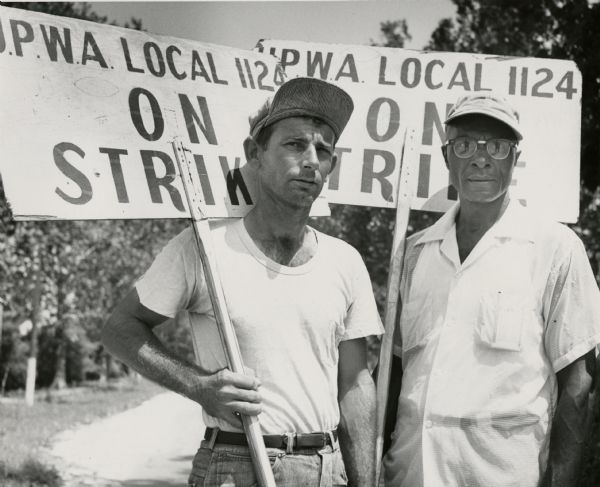 Two members of United Packinghouse Workers Local 1124 in New Orleans on strike against the Colonial Sugar Company.