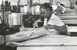 An employee of the Chase Bag company, who was also a member of the Amagalamted Meatcutters and Butcherworkers of North America, stitches at a sewing machine.