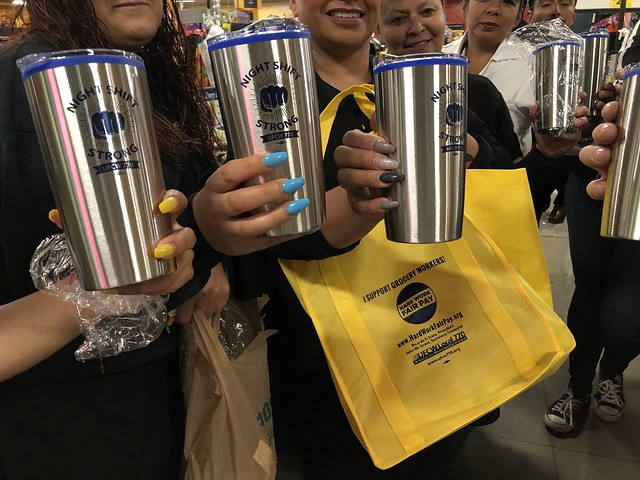 "UFCW Local 770 members hold up their ""Night Shift Strong"" mugs from Third Shift Day"