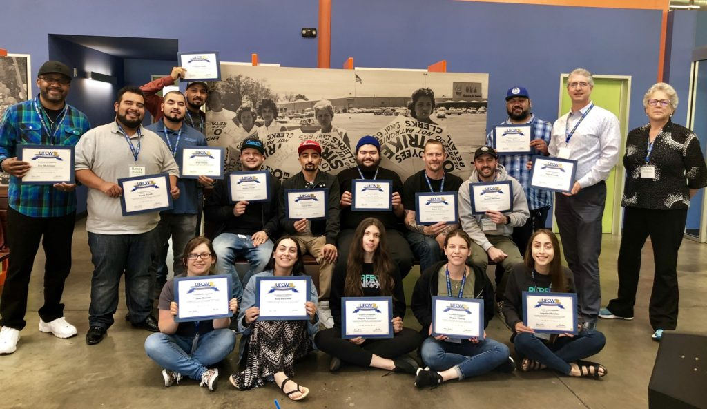 Attendees to the Cannabis OSHA Trainings at UFCW Local 770 hold up their training certificates