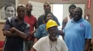 Group of Cotton Seed Co-op-workers stand together, smiling
