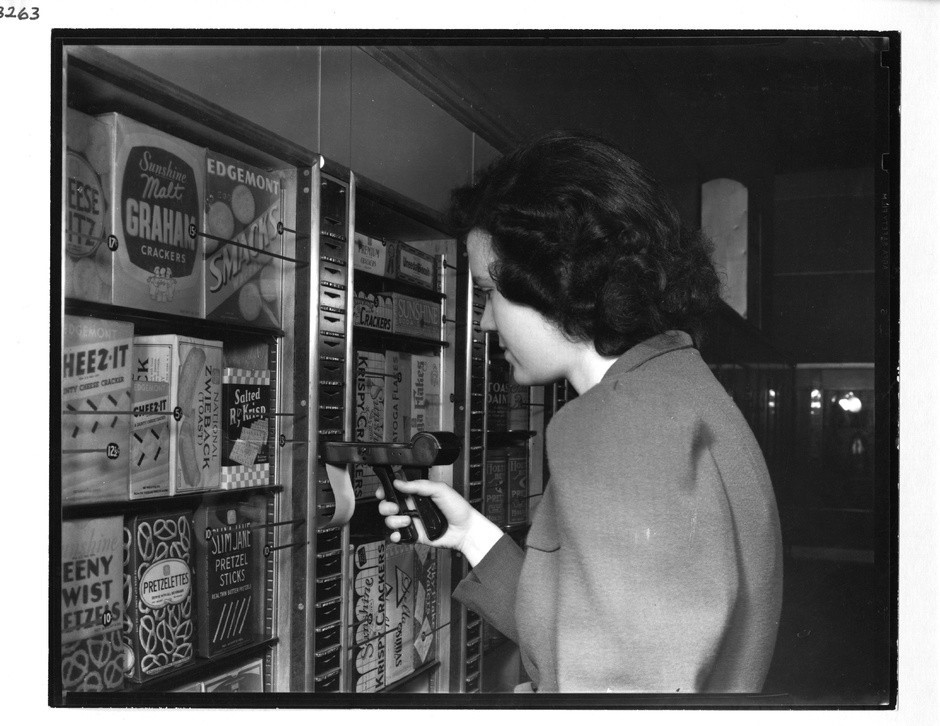 Black and white photo of a woman shopping at Keedoozle