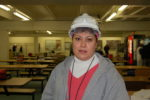 Cargill woman in hardhat stands in breakroom