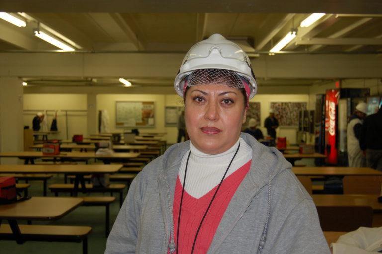 Cargill woman in hardhat stands in breakroom