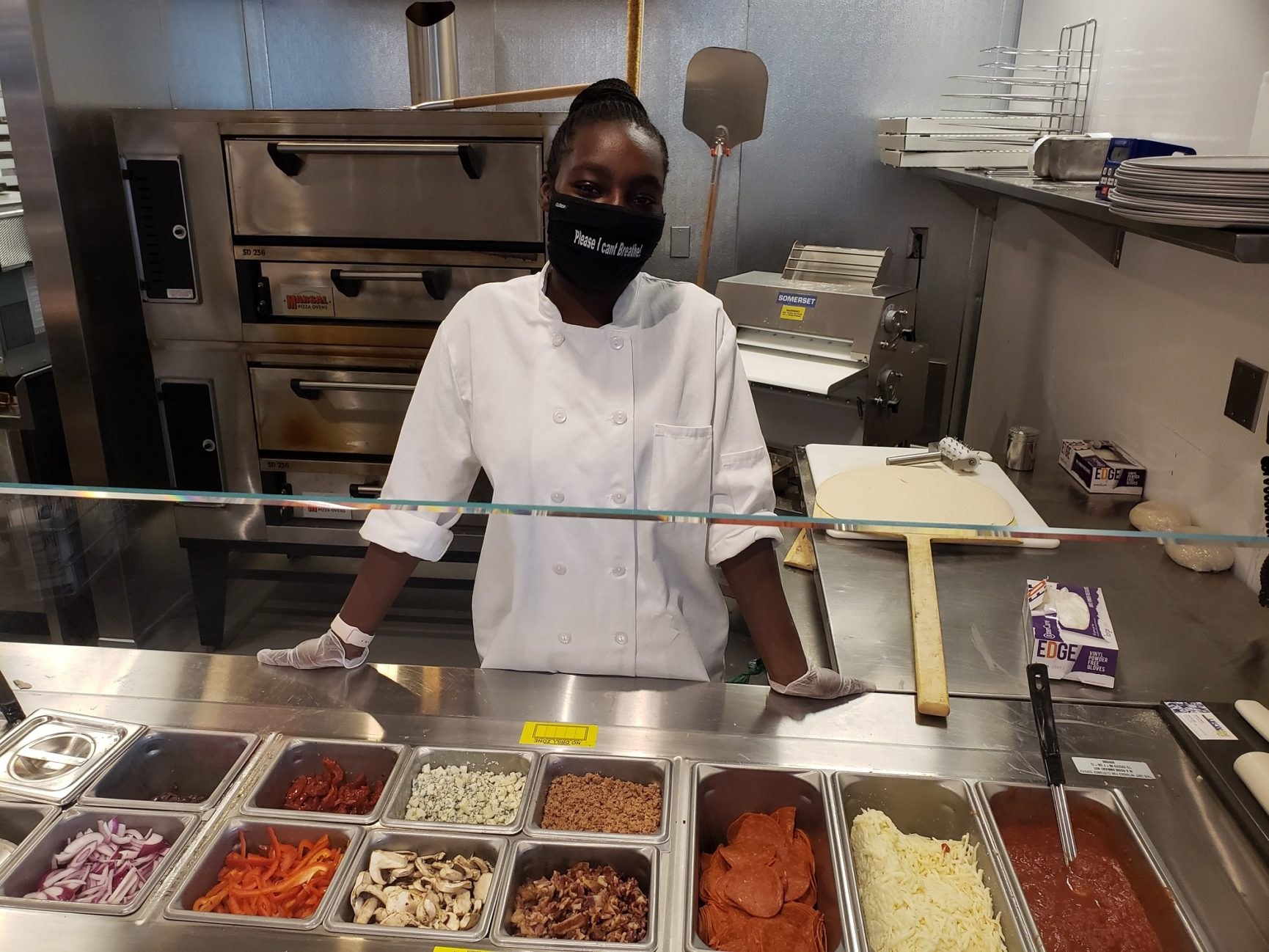 Apraisja Gee at work behind the deli counter