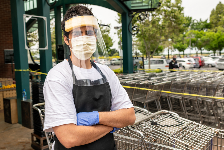 Grocery Worker with Mask and Shield