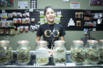 Happy cannabis female worker