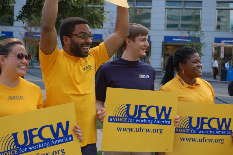 UFCW members with UFCW signs