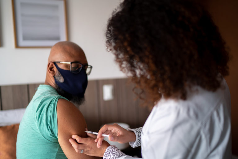 African American man getting vaccine