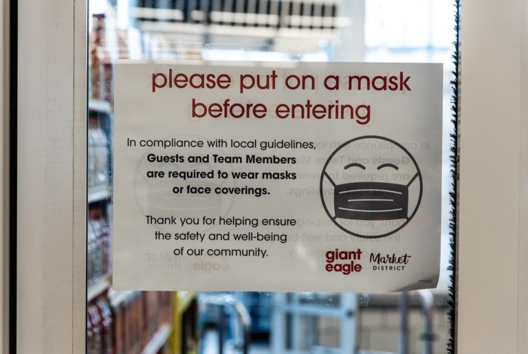 Dave's Midtown Giant Eagle Mask Sign