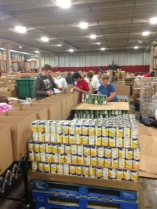 Local 1000 members preparing and packing boxes of food for tornado victims