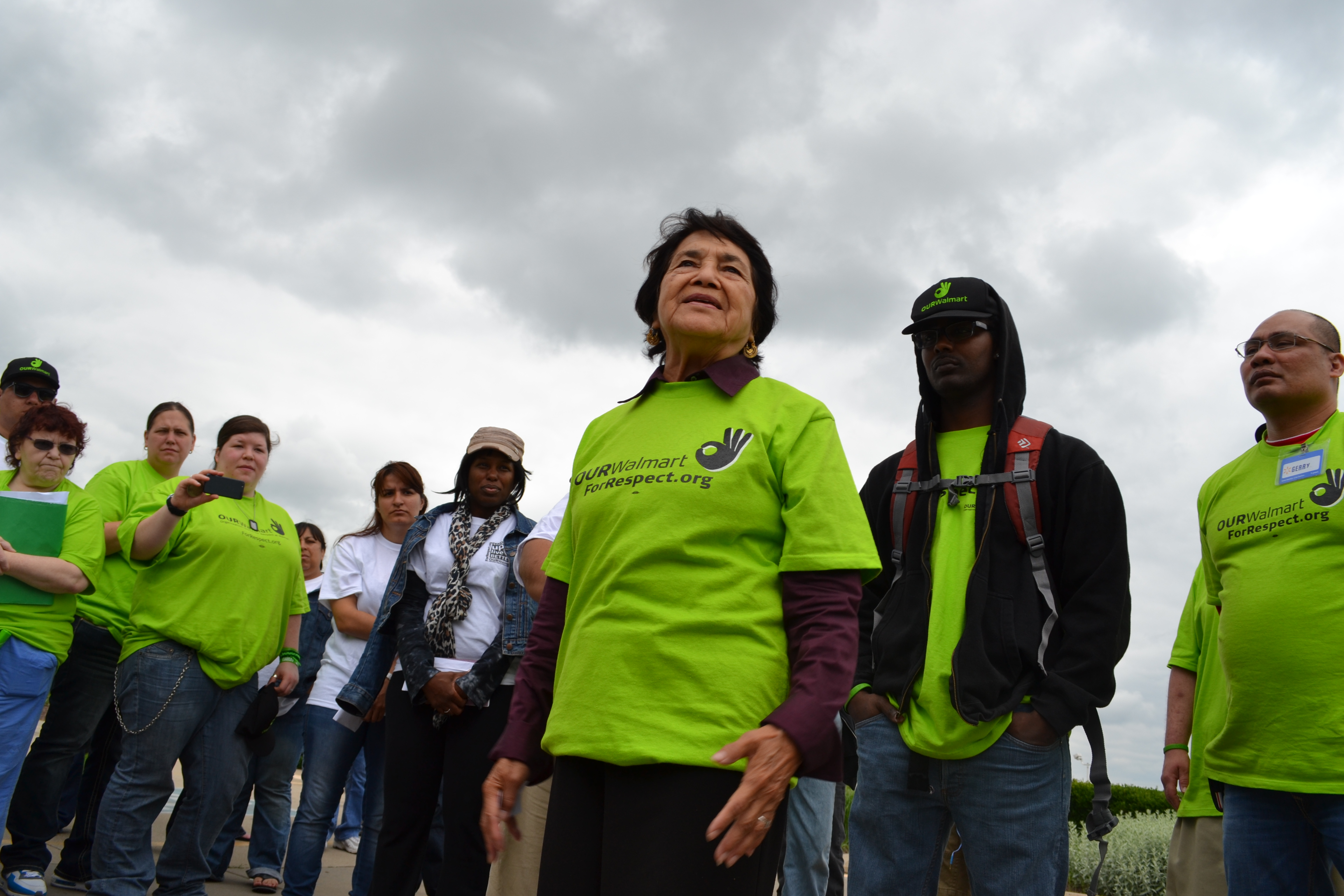 Dolores Huerta, standing with OUR Walmart members and workers during the Ride for Respect in summer 2013.