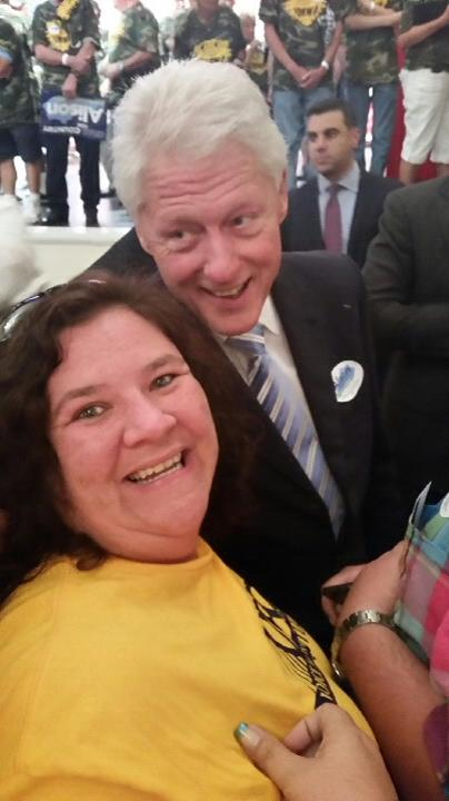 Amy, shown here with former President Clinton while she was representing UFCW Local 227 at a rally