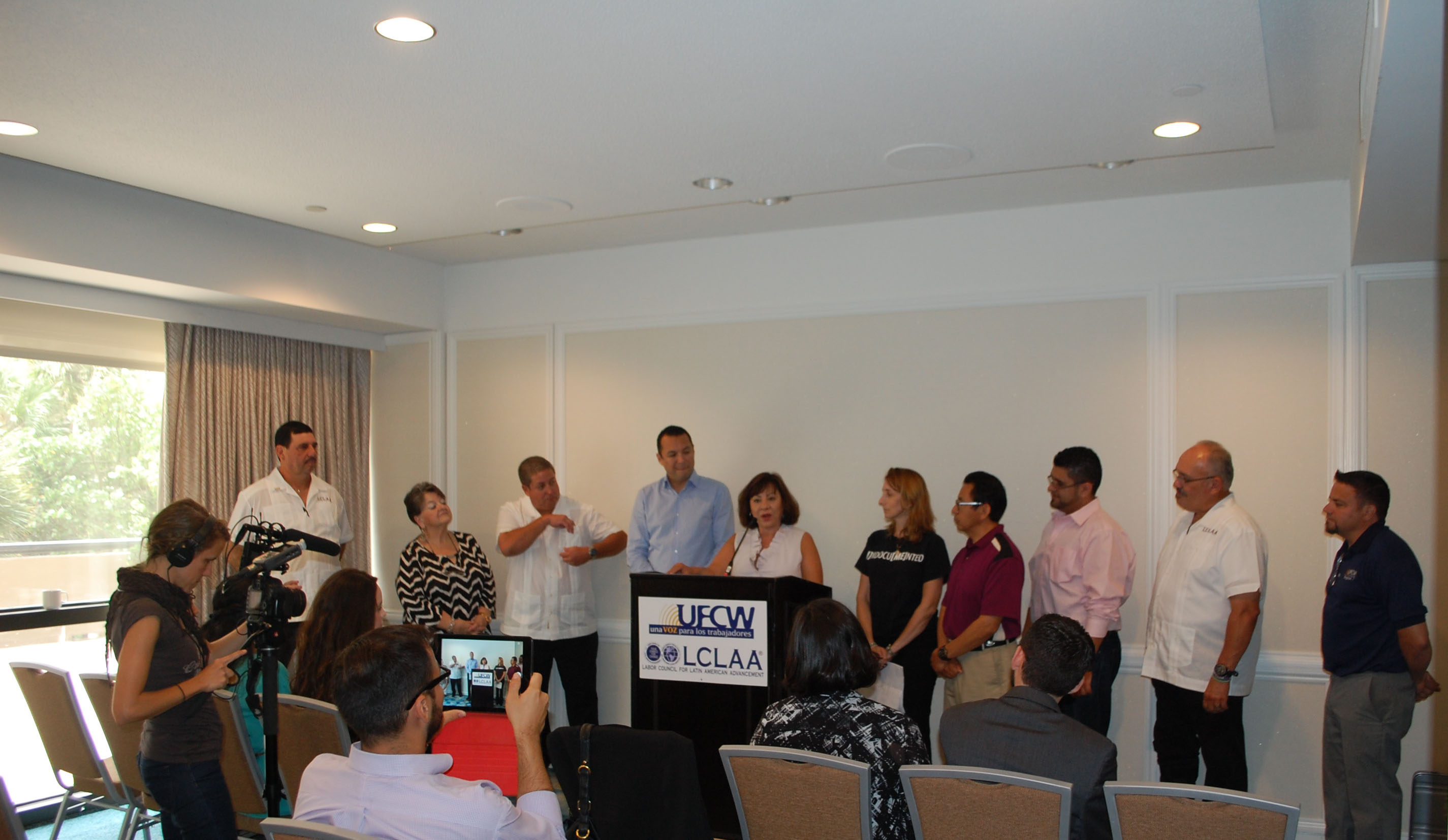 UFCW Executive Vice President Esther Lopez, accompanied by the LCLAA board, addresses the press  at LCLAA's regional conference.