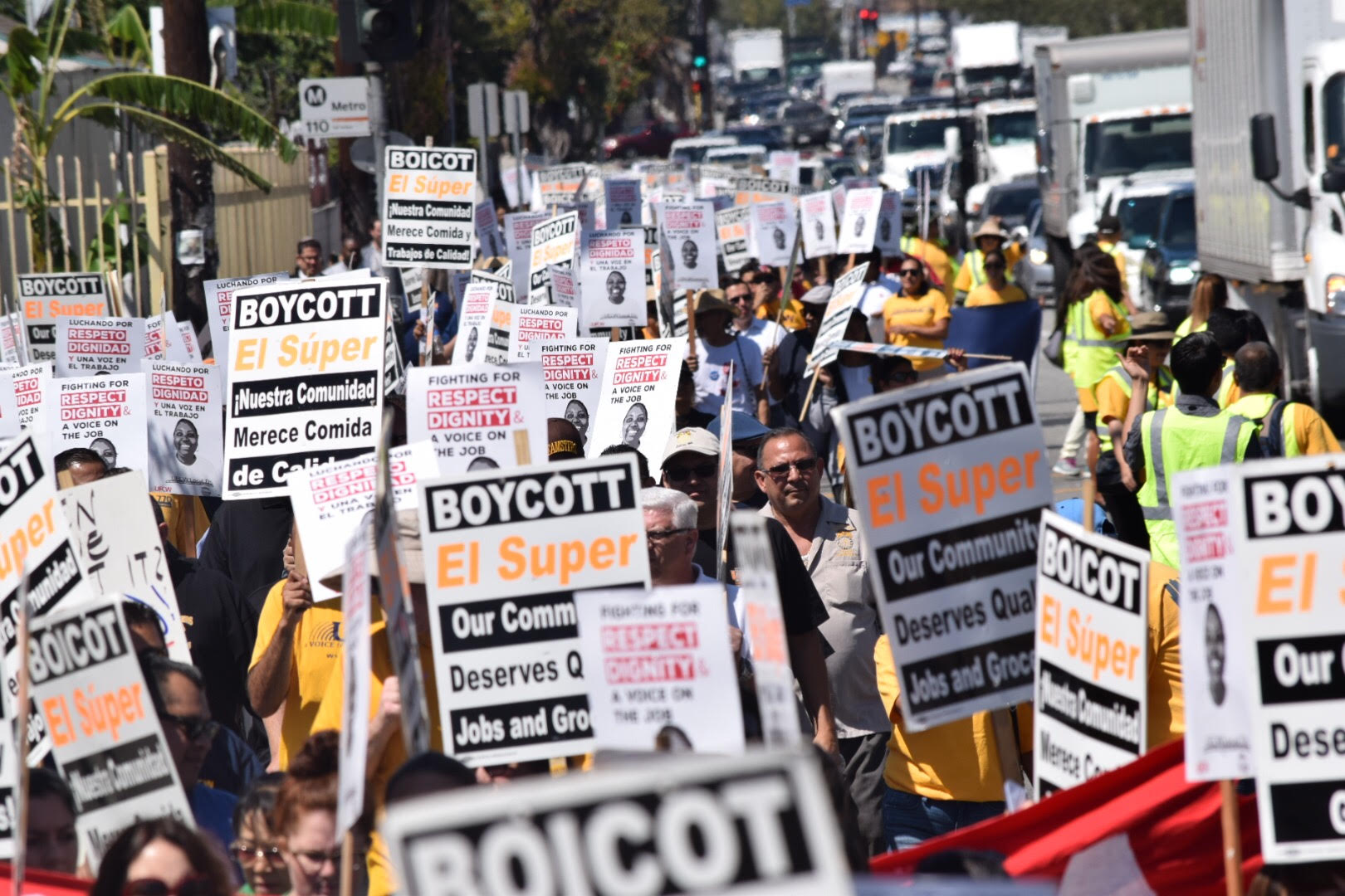"Crowd carries ""Boycott El Super"" signs"